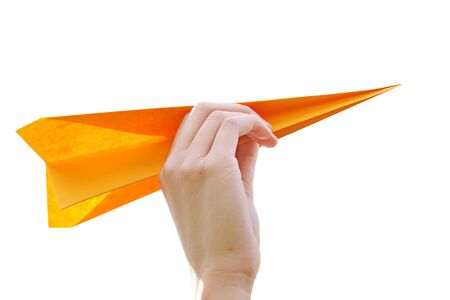 Hand launching paper airplane isolated on white