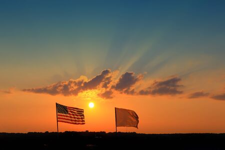 banderas americanas: American Flag in front of sunset background on the airport Foto de archivo