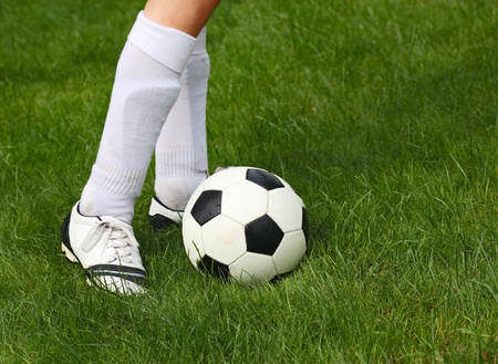 Soccer ball and football player on the field Stock Photo - 10566611