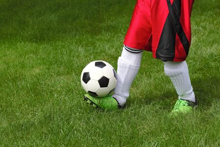 Football player guggling a soccerball Stock Photo - 10623082