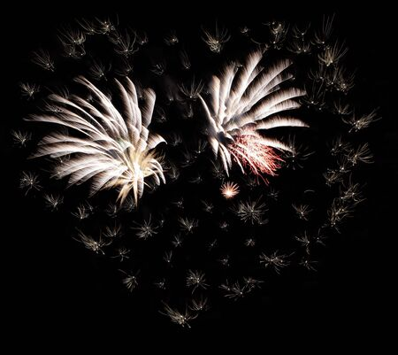 Fireworks forming a heart shape in the night sky photo
