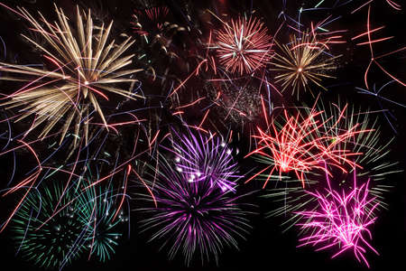 Colorful fireworks of various shapes over black night background photo