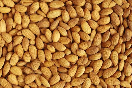 Closeup of whole almond nuts for background Banco de Imagens