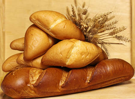 Baked bread with wheat spikes,  harvest concept photo
