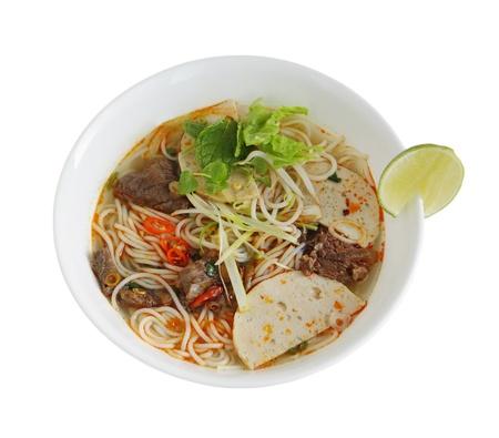 spicy: Bowl of beef rice vermicelli noodle soup, bun bo, Vietnamese cuisine