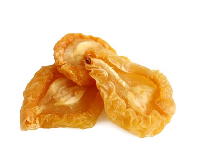 dehydrated: Three of dried pear pieces over white background
