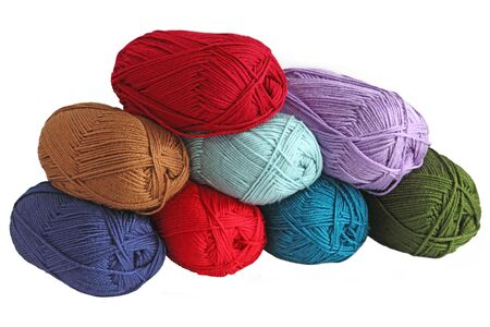 Eight yarn skeins in red, green, blue, brown colors photo