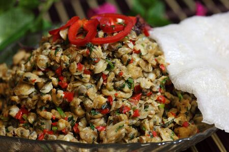 Spicy baby clam meat and rice cracker Vietnamese cuisine hen banh trang Stock Photo - 12440996