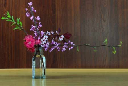 Fresh spring flowers in the bottle for seasonal  background
