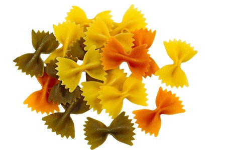 Pile of Tri Color Farfalle pasta isolated on white background photo