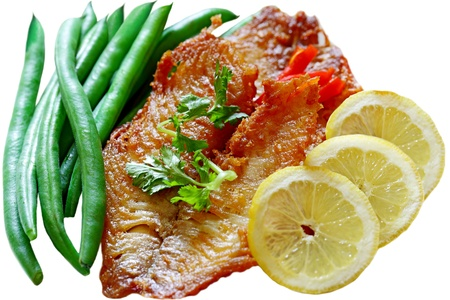 Fried tilapia fillets with green bean and lemon photo