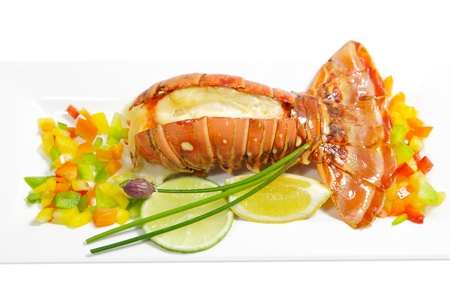 Grilled lobster tail with pepper, lemon and lime