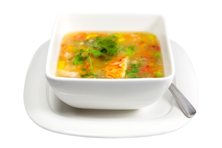 Lobster and vegetable soup isolated on white background