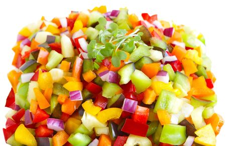 mustard plant: Young mustard green plant over colorful pepper and onion cut in cubes Stock Photo