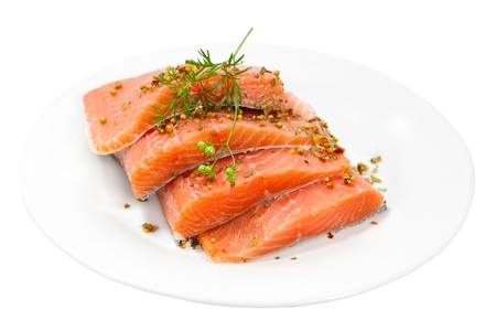 Raw salmon fillet with spices on plate photo