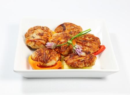 potato tuna: Tuna fishcake patties on bell peppers Stock Photo