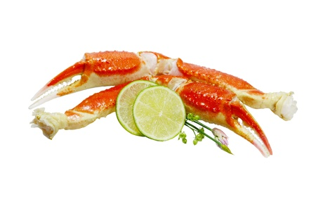 Boiled king crab legs with lime isolated on white background Фото со стока