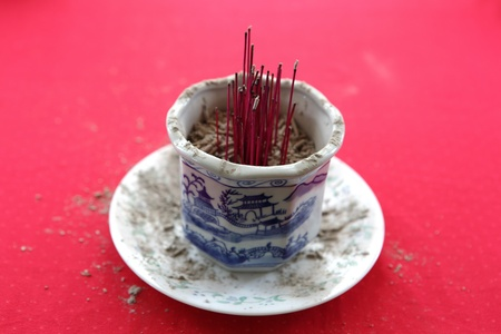Burnt joss incense sticks in the holder Stock Photo - 18269746