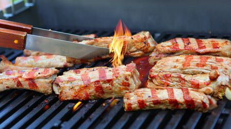 charbroiled: Pieces of pork ribs barbecue on the grill Stock Photo