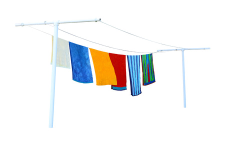Washed beach towels drying on the clothes line