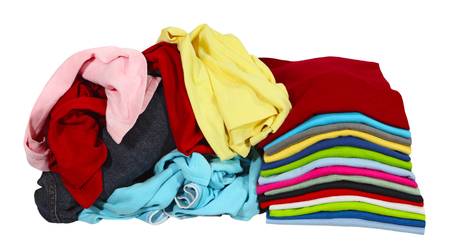 laundry pile: Stack of folded T shirt and pile of clothing