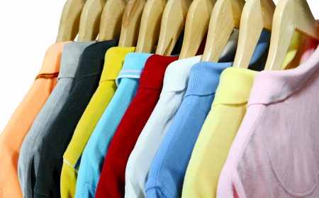 Colorful polo shirts for men on hanger isolated over white