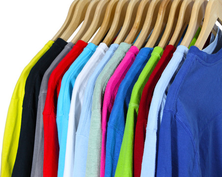 hangers: Colorful T shirts on hangers isolated on white