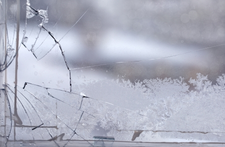 Broken window in the winter time with frost on the glass Foto de archivo