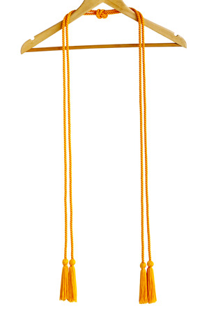 Golden color graduation honor cord on hanger isolated on white  写真素材