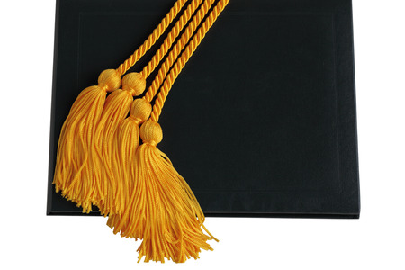 graduation background: Golden honorgraduation cords over black diploma