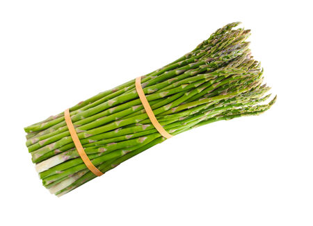 Bundle of pencil thin asparagus isolated on white background photo