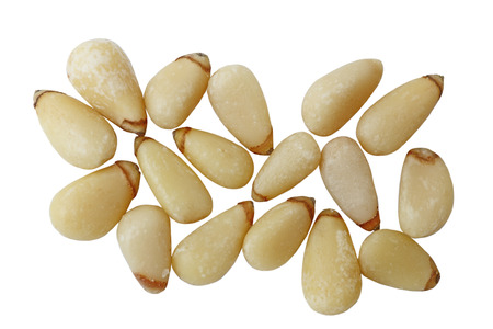 pine nuts: Raw Pine nut seeds isolated on white background