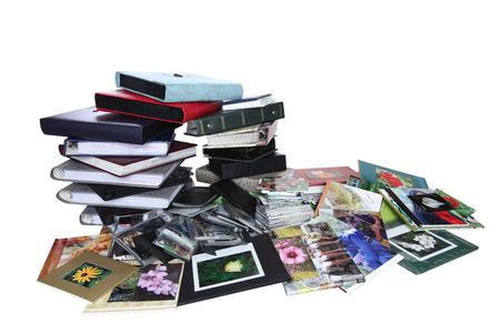 emigranti: Pila di vecchi album di foto di famiglia isolato su sfondo bianco Archivio Fotografico