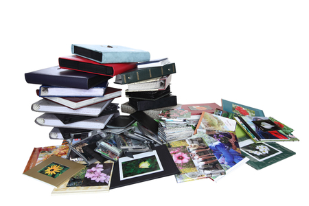 Stack of old family photo albums isolated on white background photo