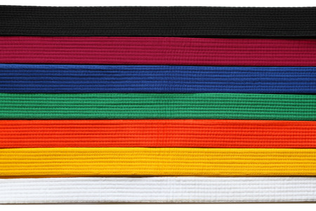 Martial Art belts in seven colors background Stock Photo