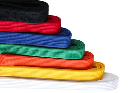 judo: Siete colores de artes marciales Taekwondo cinturones a fin de bajo a alto Foto de archivo