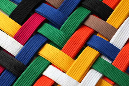 karate fighter: Colorful of martial arts belts rank system background