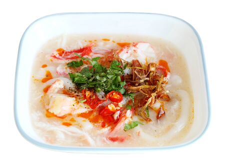 Crab meat big rice noodle soup cake isolated on white Banco de Imagens