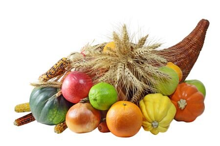 Thanksgving Cornucopia full of harvested fruits and vegetables  Stock Photo