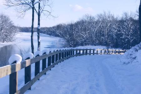 Winter landscape by frozen river