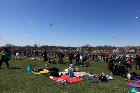 WASHINGTON, DC, USA - MARCH 31, 2018:  Crowd of people at competition field on the Blossom Kite Festival held on the ground of Washington Monument