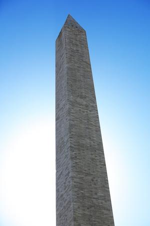 Closeup of the Washington Monument landmark over blue sky