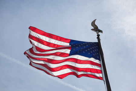 American flag flying in blue sky in the springtime