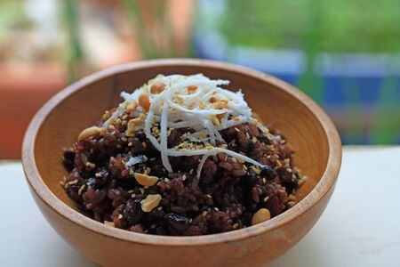 Glutinous Rice with black bean, peanut and coconut