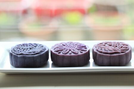 Purple moon cake make from Baby purple potatoes filling with mung bean