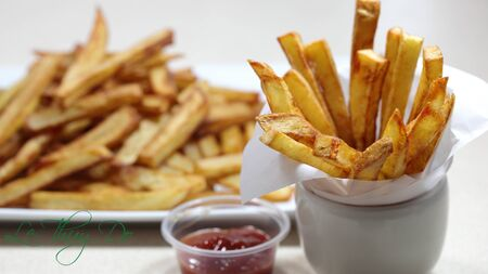 Homemade french fries with tomato sauce