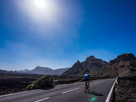 Tenerife, Spain - June 2 2019 - Cyclist biking around the volcanic landscape of Teide National Park in Tenerife Canary Islands Spain Editorial