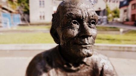scotish: Bronze grandpa monument in Scotish Highlands in summer