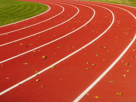 perseverance: Red Running Track with white lines  at stadium
