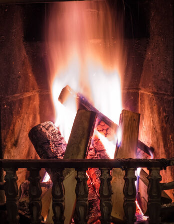 cosy: Burning fire in the fireplace. Cosy place